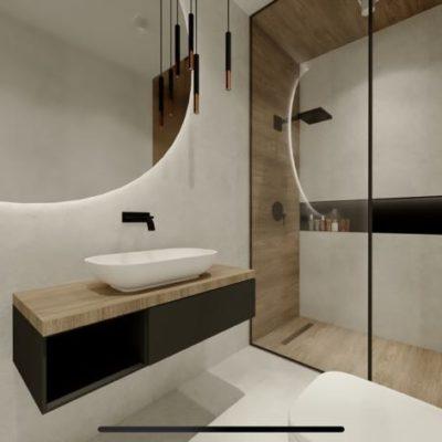 nowoczesna łazienka; czarna szafka pod umywalką; drewniany blat w łazience; lustro okrągłe podświetlane; czarna wnęka w kabinie